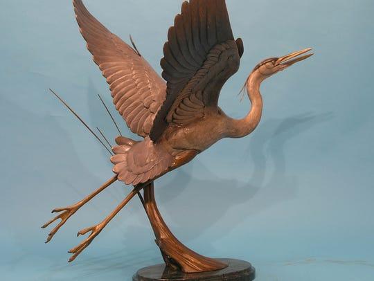 "David Turner's ""Taking Flight"" sculpture is one of"