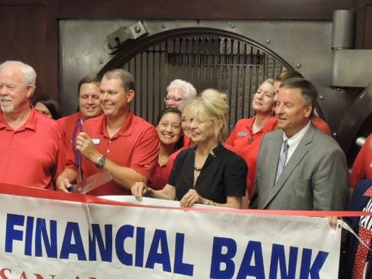 Local dignitaries joined the banking family of First