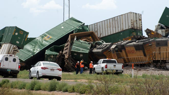 Twisted and mangled train cars could be seen off Interstate 10 from the westbound lanes Tuesday when a Union Pacific train derailed west of Deming.