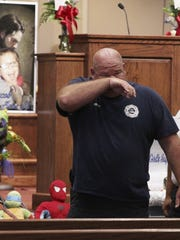 Townville Fire Chief Billy McAdams wipes tears during