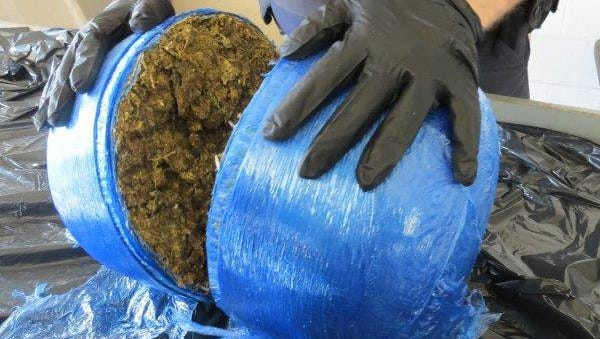 Canadian agents seized a parcel containing 14 pounds of suspected marijuana at a Detroit-Windsor border crossing.