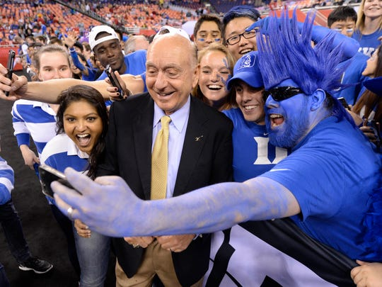 Dick Vitale of ESPN takes selfie pictures with Duke
