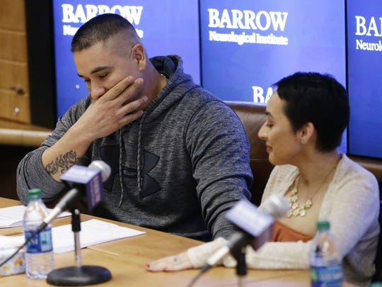 Frank Calzadillas is overcome while talking about his wife's, Jovanna Calzadillas recovery during a press conference at Barrow Neurological Institute on Jan. 24, 2018, in Phoenix, Ariz. Jovanna Calzadillas will be discharged from the hospital tomorrow. Calzadillas was shot in the head on Oct. 1, 2017, when a gunman opened fire on the Route 91 Harvest music festival in Las Vegas, Nevada.