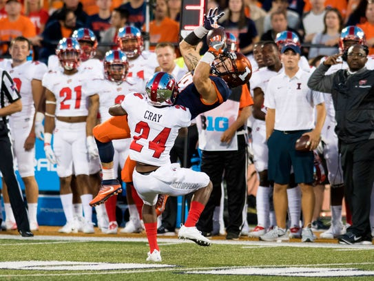 Illinois wide receiver Mike Dudek (18) cannot hold