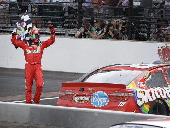 Sprint Cup Series driver Kyle Busch (18) celebrates
