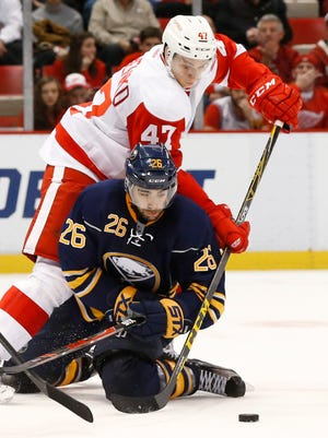 Detroit Red Wings defenseman Alexey Marchenko (47) defends against the Buffalo Sabres on Dec. 14, 2015, in Detroit.