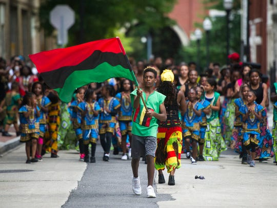 Marquis Ellis marches with the Pan-African flag while