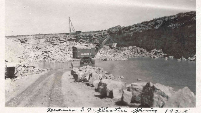 In this circa 1920s photo, a large Marion electric shovel is used to load stone in the primary crusher.
