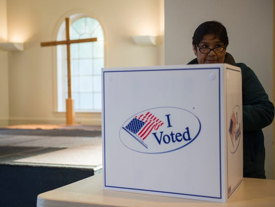 A woman cast her ballot at a church polling station