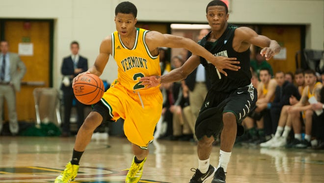 Vermont guard Trae Bell-Haynes drives to the hoop in Monday's game against Binghamton at Patrick Gymnasium.