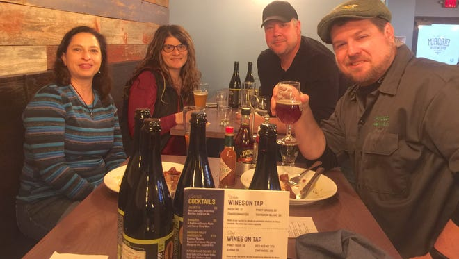 Laura and Patrick Wright, front, and Chad and Cari Wolf, back, became friends during the Black Friday special release at Explorium Brew Pub