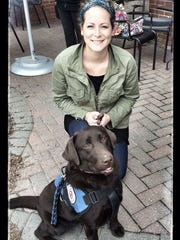 Lindy Zulick with Tabitha, the Chocolate Lab alert dog that has improved her life tremendously.