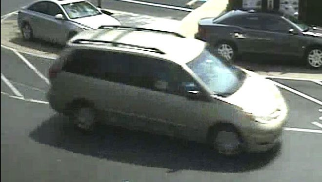 Police seek the man who was driving this minivan when it struck a woman Friday in the parking lot of a Chick-fil-A restaurant in Gloucester Township.