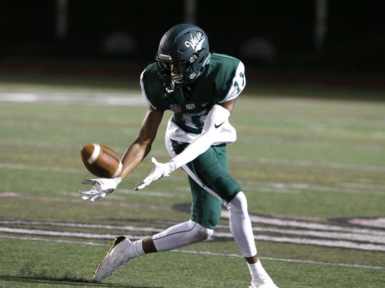Long Branch wide receiver Timothy Fosque (11) makes a catch and runs for a touchdown during high school football game against Manasqaun at Long Branch High School, Long Branch,NJ.  Friday, September 8, 2017.  Noah K. Murray-Correspondent Asbury Park Press