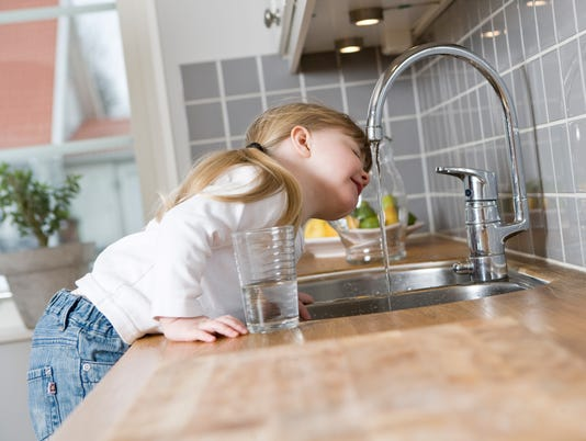Small Girl drinking water