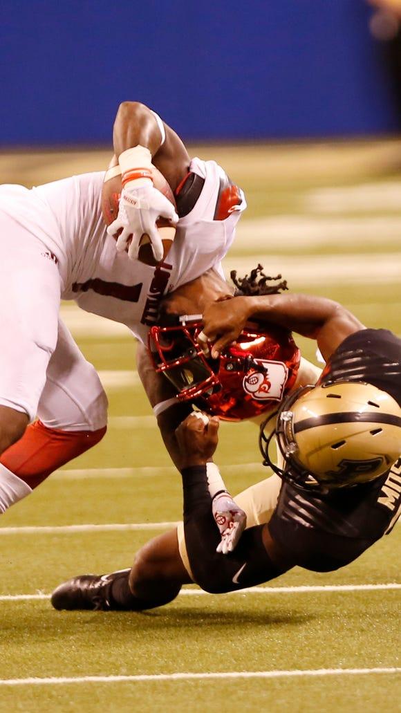 Purdue's Navon Mosley tackles Louisville wide receiver