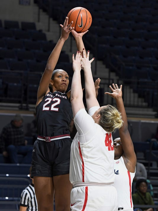 FILE - In this Jan. 4, 2018, file photo, South Carolina forward A'ja Wilson (22) takes a shot over Mississippi forward Shelby Gibson (42) during the first half of an NCAA college basketball game, in Oxford, Miss. A'ja Wilson is the Associated Press' Southeastern Conference women's basketball player of the year for a third consecutive season, the all-SEC team announced Tuesday, Feb. 27, 2018.(AP Photo/Thomas Graning, File)