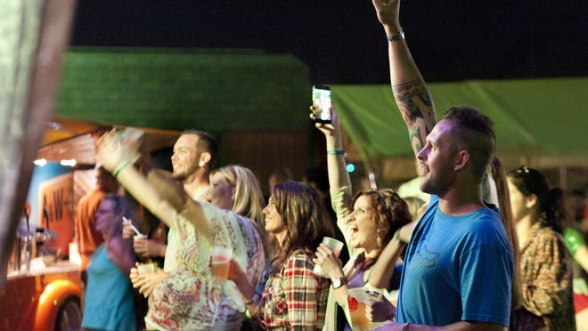 """Oktoberfest regularly host local musical acts. In this photo from Oktoberfest 2014, Steve Boertje, right, and friends listen to local band """"Leaving Austin"""" on Thursday."""