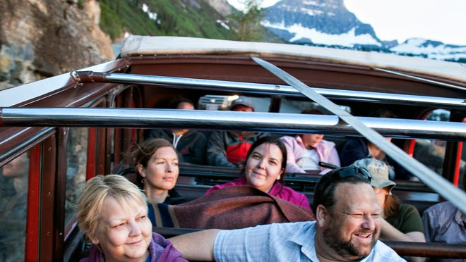 In this photo taken July 2, Rhonda Hendricks, left, her husband, Doug, right, and their daughter, Vicki Sims, right center, enjoy a ride in a Red Bus along Going-to-the-Sun Road in Glacier National Park near West Glacier. Rhonda is currently in hospice care due to terminal ovarian cancer.