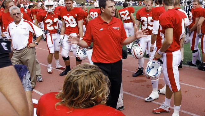 Jim Gagliardi talks with players during a St.John's game in 2014 at Clemens Stadium. Gagliardi is taking on a new role within the athletic department after 26 seasons as head coach.