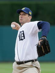 Jim Harbaugh throws out the first pitch at Comerica Park during a game in June last season.