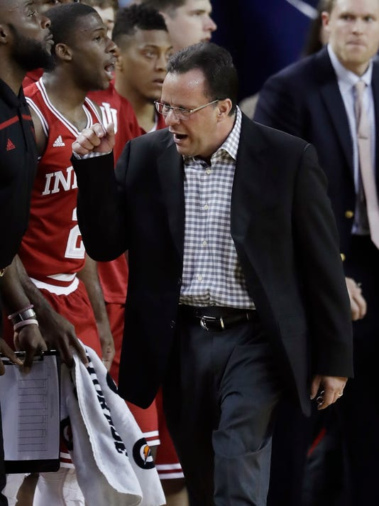In this Thursday, Jan. 26, 2017, photo, Indiana head coach Tom Crean walks the sidelines during the first half of an NCAA college basketball game against Michigan in Ann Arbor, Mich. Indiana has home games against No. 16 Purdue on Thursday, Feb. 9, and Michigan on Sunday. The Hoosiers face four of their last five regular season games on the road, where coach Tom Crean's team was just 1-5 entering weekend play. (AP Photo/Carlos Osorio)