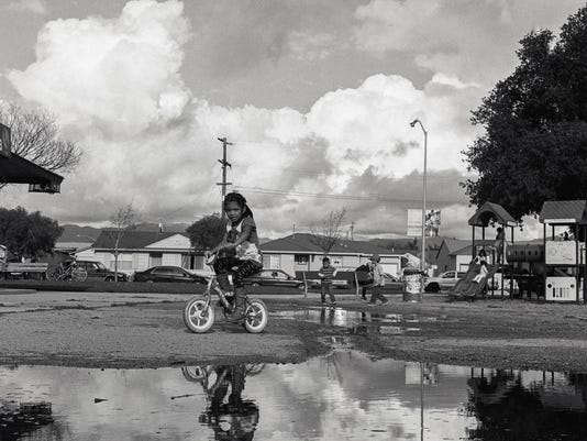 636688218008898608-Riding-through-the-puddle.jpg