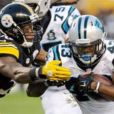 Carolina Panthers running back Fozzy Whittaker (43) is hit by Pittsburgh Steelers outside linebacker Ryan Shazier (50) in the first quarter of the NFL preseason football game on Thursday, Aug. 28, 2014 in Pittsburgh.