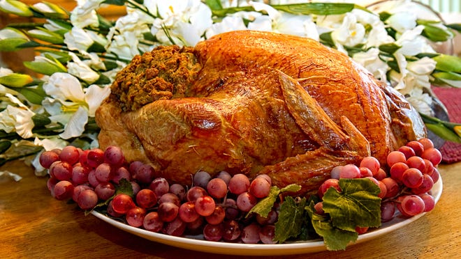 Turkey dinners, and the gasoline to get to them, are both a little cheaper this year, reducing the strain on consumers' wallets just in time for holiday shopping.