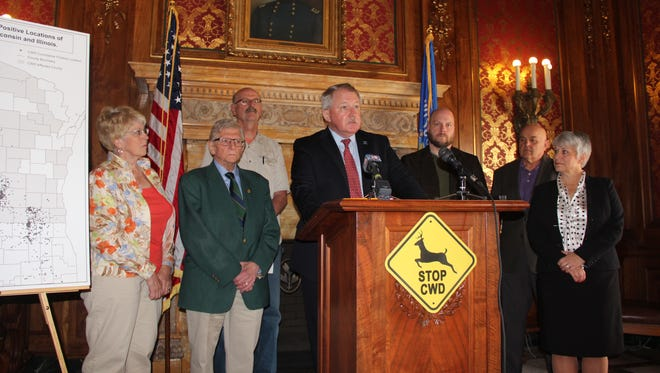 Rep. Dana Wachs (D-Eau Claire) speaks Wednesday at news conference in Madison announcing a bill to strengthen fencing requirements at Wisconsin deer farms. Wachs was surrounded by supporters of the bill and fellow lawmakers.