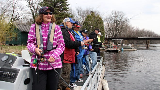 Members of Wisconsin Women Fish, a group dedicated to helping female anglers learn and enjoy the sport, fish from a pontoon boat on the Wolf River at Gill's Landing, Wis.