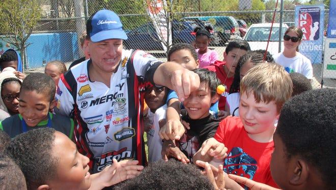 Greg Karch of Oshkosh works  to teach fishing to Milwaukee youth.