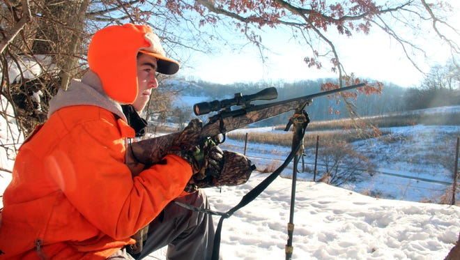 Matthew Ammel of Menomonee Falls watches for deer while on a gun deer hunt in Richland County. Photo by Paul A. Smith.
