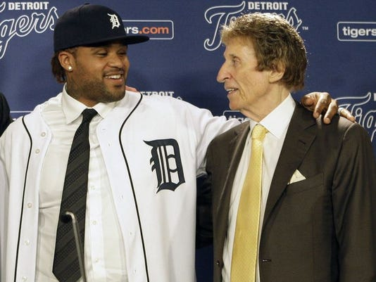Prince Fielder, left, poses with Tigers owner Mike Ilitch at a news conference at Comerica Park in Detroit on Thursday,