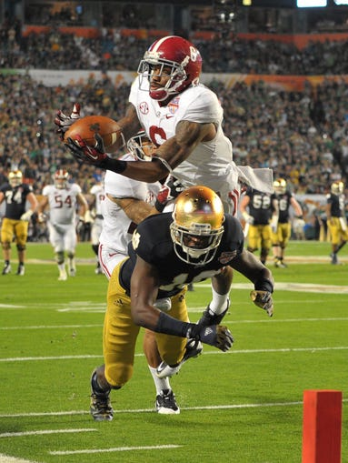 January 7: Alabama Crimson Tide defensive back Ha Ha Clinton-Dix intercepts a pass intended for Notre Dame Fighting Irish wide receiver DaVaris Daniels during the second half of the 2013 BCS Championship game at Sun Life Stadium.