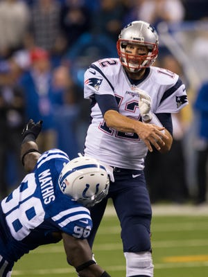 Tom Brady watches a pass as he is pursued by Robert Mathis of The Colts, New England Patriots at Indianapolis Colts, Sunday, Oct. 18, 2015.