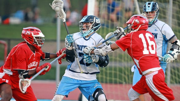 Suffern Kyle Foresta (23) tries to protect the ball