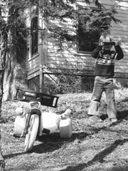 A 1979 photograph taken by Cornell graduate Gregory Tate. The photo series was taken for a class assignment during the Spring 1979 semester. As Tate was photographing, the young boy took out a camera of his own and started photographing Tate.