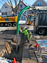 Milwaukee Public Works Department crews repair a break in the city-owned section of a lead service lateral between the water main and a private property boundary in the 2100 block of S. 14th St. last January.