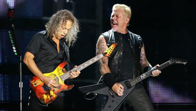 Kirk Hammett and James Hetfield of Metallica perform onstage on Friday, Aug. 4, 2017 at University of Phoenix Stadium in Glendale, Ariz.
