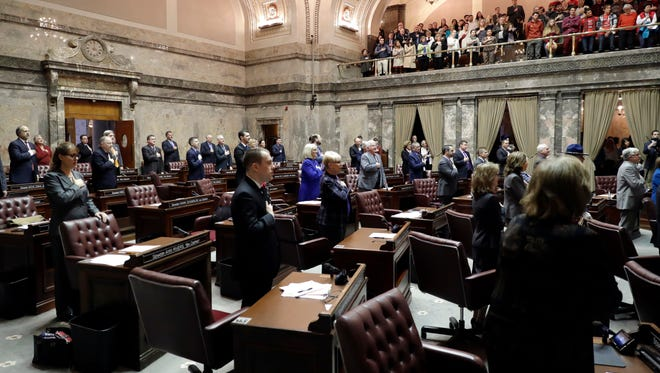 Washington State senators stand during the pledge of allegiance on Monday, the opening day of the 2018 legislative session.