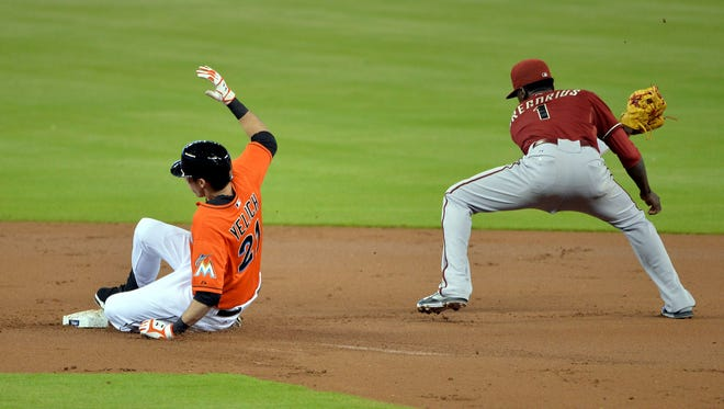 Aug 16, 2014: Arizona Diamondbacks shortstop Didi Gregorius (1) waits on the throw as Miami Marlins left fielder Christian Yelich (21) slides into second base after hitting a double during the first inning at Marlins Ballpark.