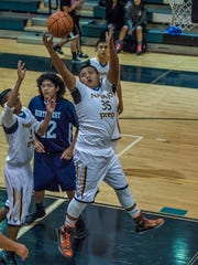 Navajo Prep's Dylan Begay grabs a rebound against Shiprock Northwest on Dec. 2 at the Eagles Nest in Farmington.