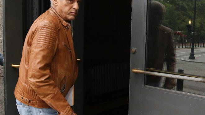 Louis Colavecchio walks into the federal courthouse in Providence in August 2019.