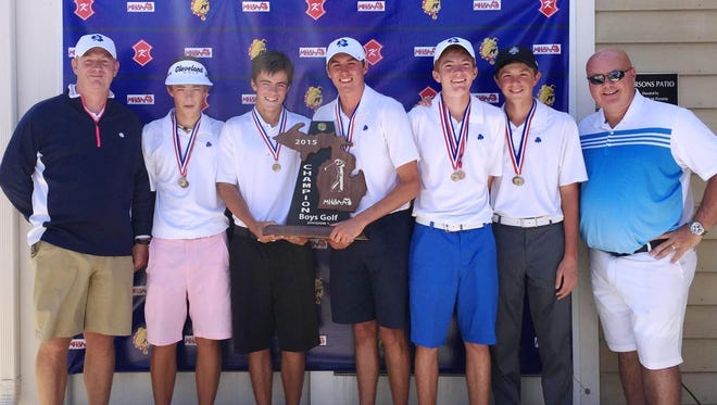 Members of Catholic Central's Division 1 boys state championship golf team include (from left): head coach Mike Anderson, James Piot, Glenn Piot, Will Coffman, Max Palmer, Ben Smith and assistant coach Rick Williams.