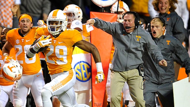 Butch Jones cheers on Tennessee's Evan Berry (29) as he returns a kickoff for UT's first touchdown against Arkansas on Oct. 3, 2015.
