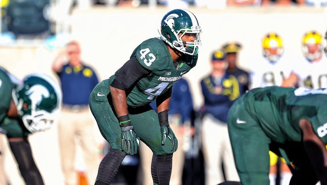 Michigan State linebacker Ed Davis looks over the Michigan offense during a game at Spartan Stadium.