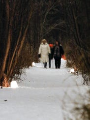 The Woodland Dunes Nature Center hosts a candlelight hike every February.