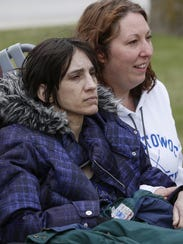 Challise Rosinsky and Nicole Meissner watch the Manitowoc