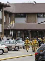 Smoke streams out of the third floor of the Parkview